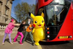 Pikachu getting onto a bus
